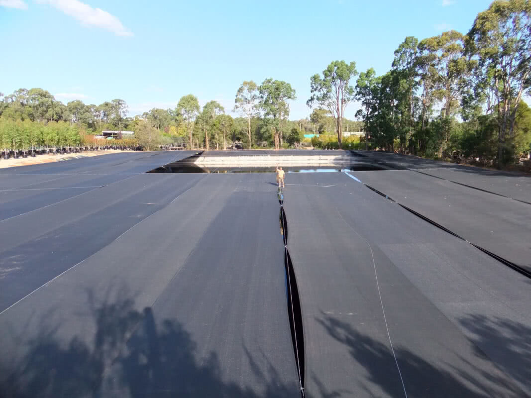 Evaporation reduction shade cloth cable span dam shade cover with GreenLife Structures'