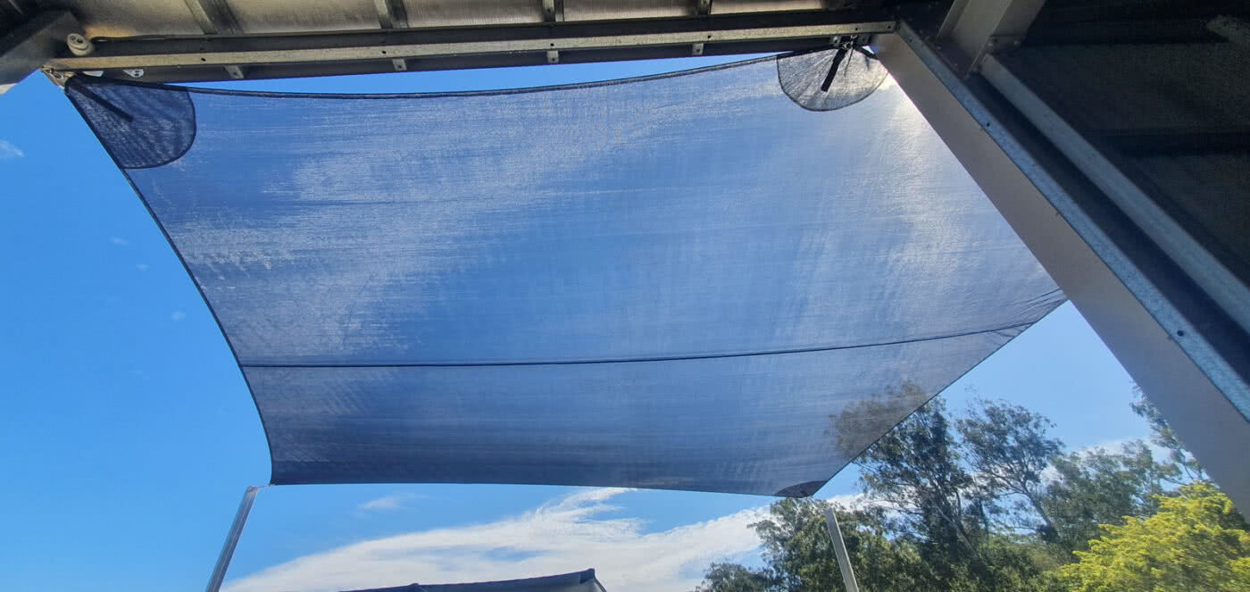 GreenLife Structures' asset protection shade sail over truck bay