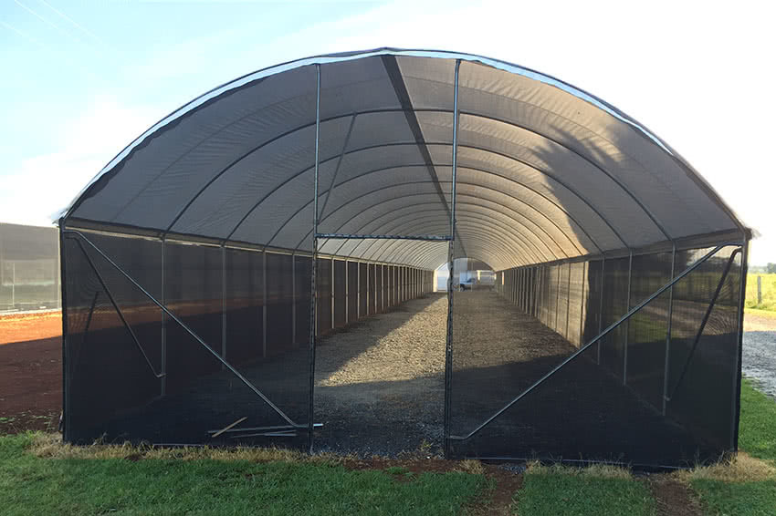 Shade cover for indoor plant nursery using habitat frame